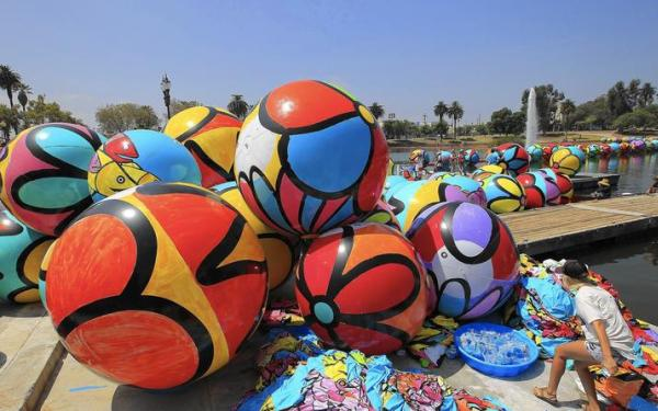 Candy-colored spheres bring MacArthur Park's lake alive