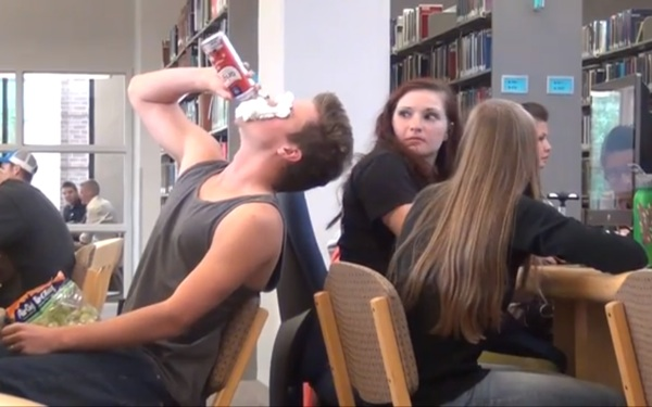 WATCH: College Guy Eats Loudly, Pranks Students in Library
