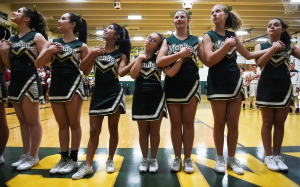 High school cheers on varsity squad member with Down syndrome