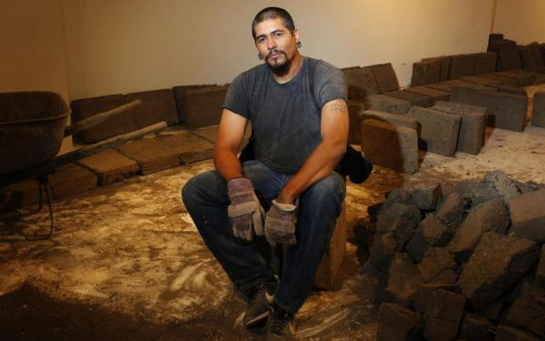 Artist Rafa Esparza is using 5,000 adobe bricks to make a building-inside-a-building in Hollywood