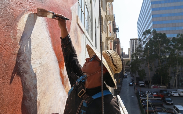 Muralist Robert Vargas is painting a towering history of LA above the traffic