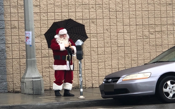 Breaking News - Santa Claus spotted in the rain on La Brea