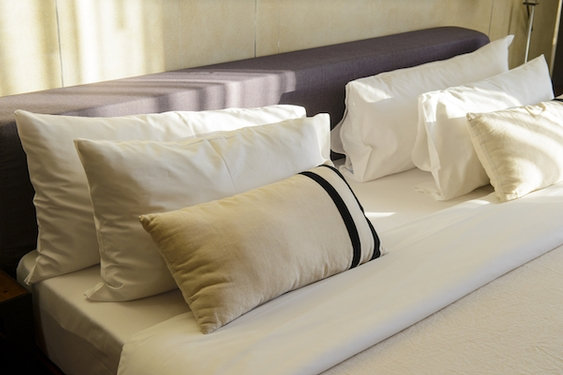 How to turn your bed into a luxury hotel heaven: Sheets and techniques you need now