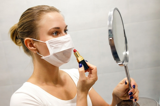 Is my mask less effective if I wear makeup?