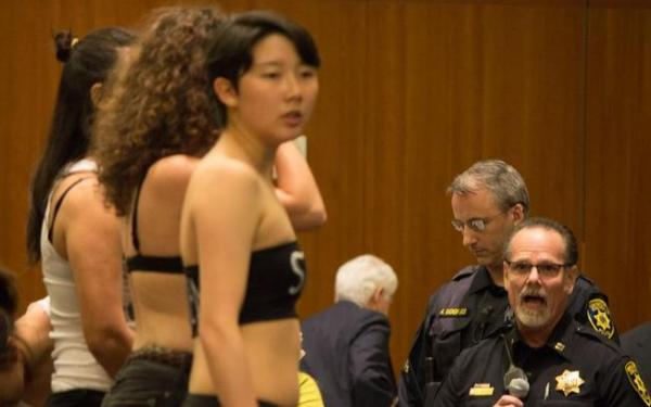 Students strip down in demonstration at UC regents meeting