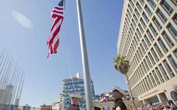 Stars and Stripes fly over U.S. Embassy in Havana for first time in half century