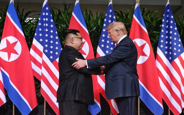 Trump, Kim begin push for peace at summit